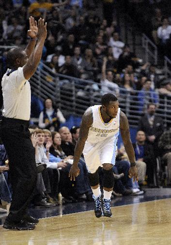 Denver Nuggets guard Nate Robinson (10) celebrates a 3-point basket against the Atlanta Hawks during the second quarter of an NBA basketball game Thursday, Nov. 7, 2013, in Denver