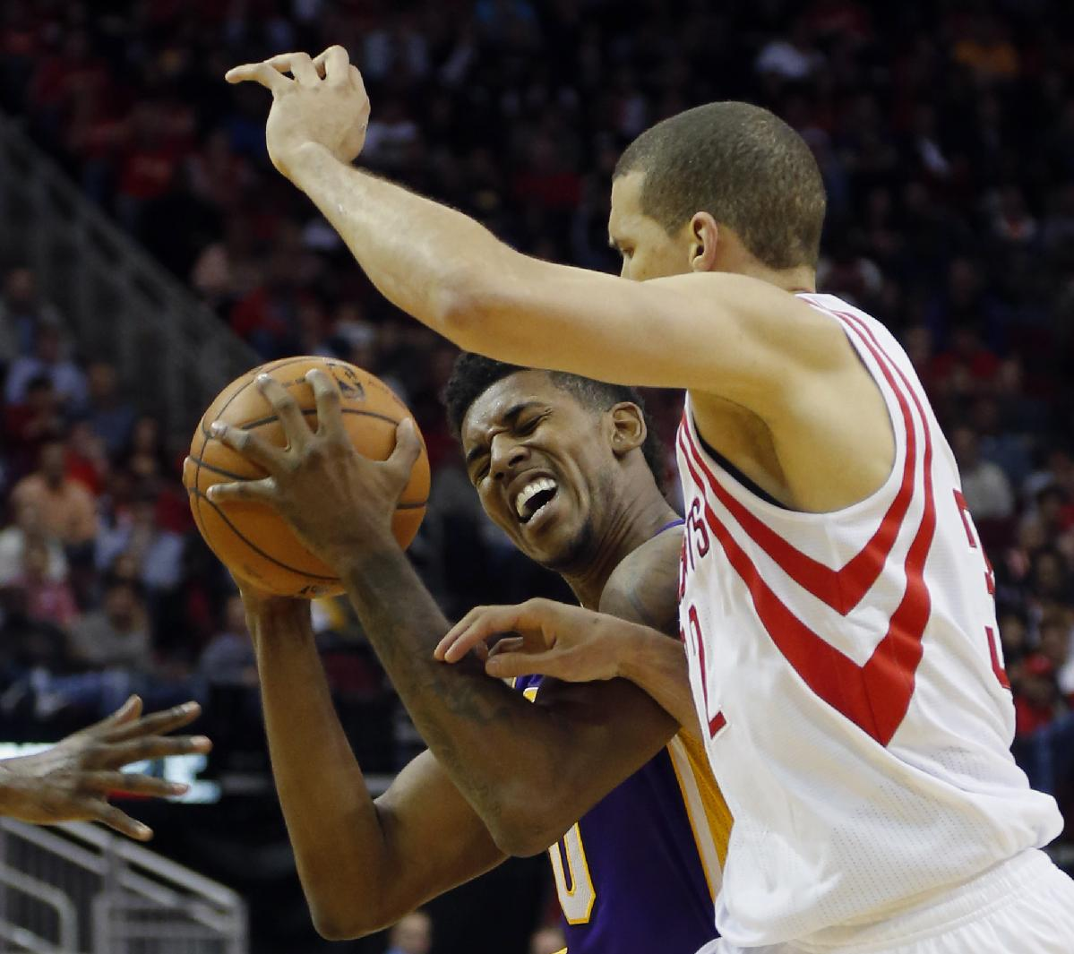 Los Angeles Lakers' Nick Young, left, is fouled by Houston Rockets' Francisco Garcia, right, during the second quarter of an NBA basketball game Thursday, Nov. 7, 2013, in Houston