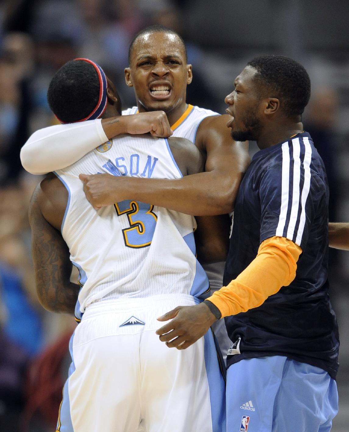 Denver Nuggets guard Ty Lawson (3) is congratulated by teammates Randy Foye and Nate Robinson, right, after hitting a 3-point basket against the Atlanta Hawks during the fourth quarter of an NBA basketball game Thursday, Nov. 7, 2013, in Denver. Denver won 109-107