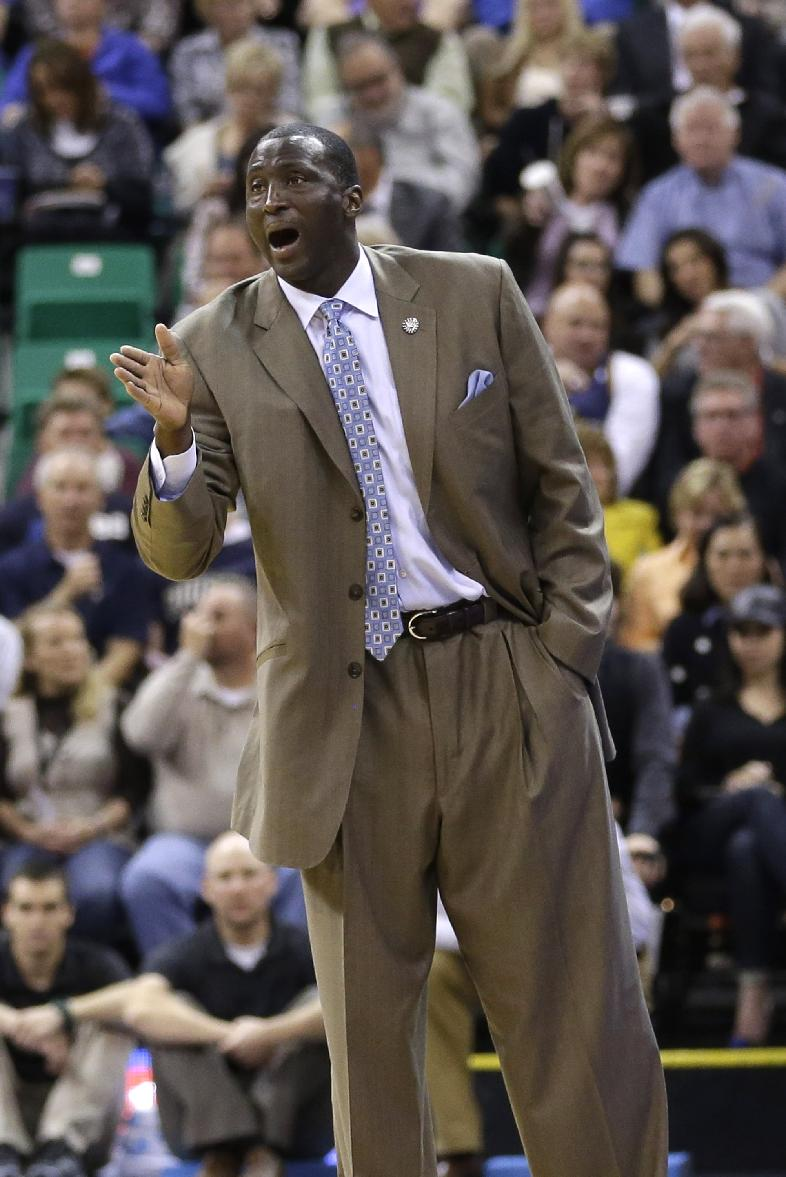 Utah Jazz head coach Tyrone Corbin shouts to his team in the first quarter during an NBA basketball game against the Denver Nuggets Monday, Nov. 11, 2013, in Salt Lake City