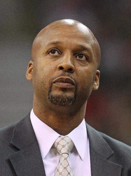 Denver Nuggets head coach Brian Shaw looks at the scoreboard in the first quarter during an NBA basketball game against the Utah Jazz Monday, Nov. 11, 2013, in Salt Lake City