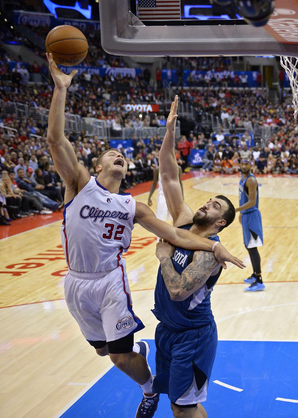 Los Angeles Clippers forward Blake Griffin, left, puts up a shot as Minnesota Timberwolves center Nikola Pekovic, of Montenegro, defends during the second half of an NBA basketball game, Monday, Nov. 11, 2013, in Los Angeles. The Clippers won 109-107