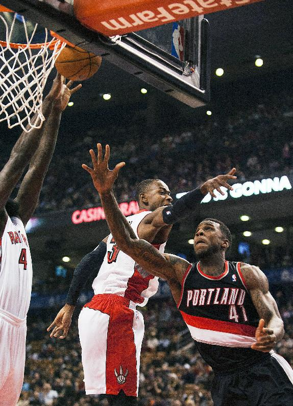 Portland Trail Blazers' Thomas Robinson (41) goes to the net against Toronto Raptors Terrence Ross during an NBA basketball game in Toronto on Sunday, Nov. 17, 2013