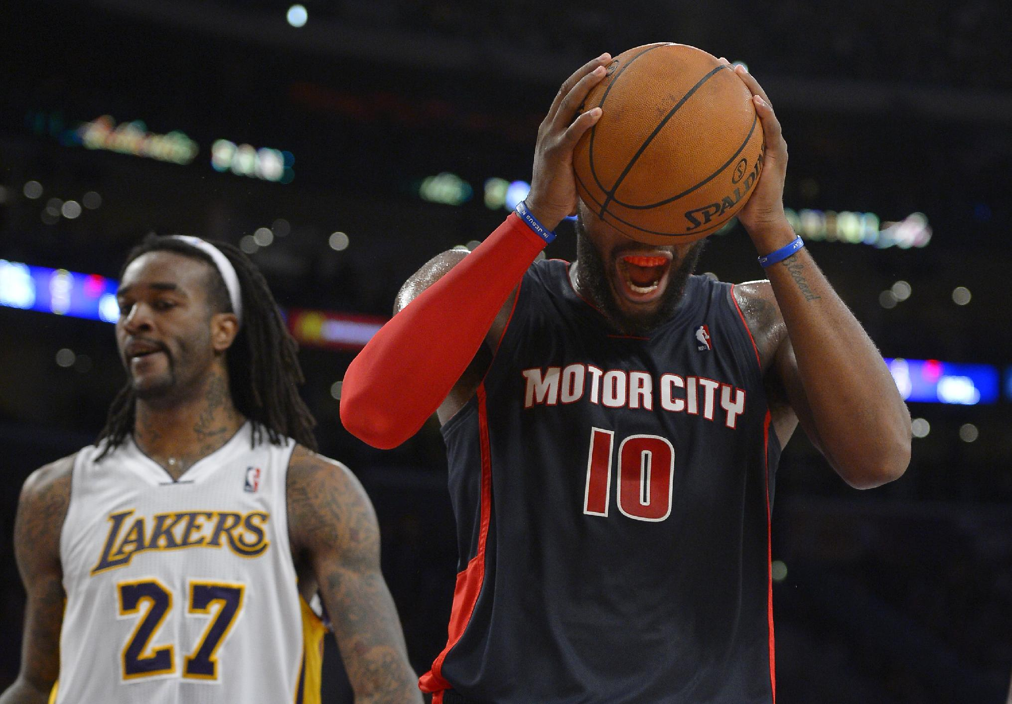 Detroit Pistons forward Greg Monroe, right, reacts after missing a shot as Los Angeles Lakers center Jordan Hill stands by during the second half of an NBA basketball game Sunday, Nov. 17, 2013, in Los Angeles