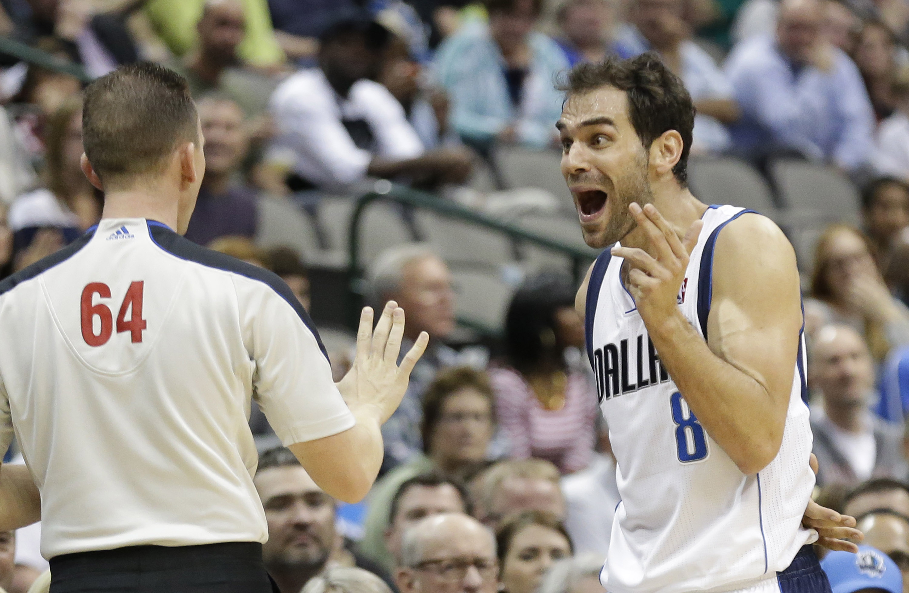 Dallas Mavericks guard Jose Calderon (8) of Spain reacts to an out-of-bounds call against the Mavericks by referee Justin VanDuyne (64) during the second half of an NBA basketball game against the Philadelphia 76ers in Dallas, Monday, Nov. 18, 2013. The call was overturned on a replay giving the Mavericks possession. The Mavericks won 97-94