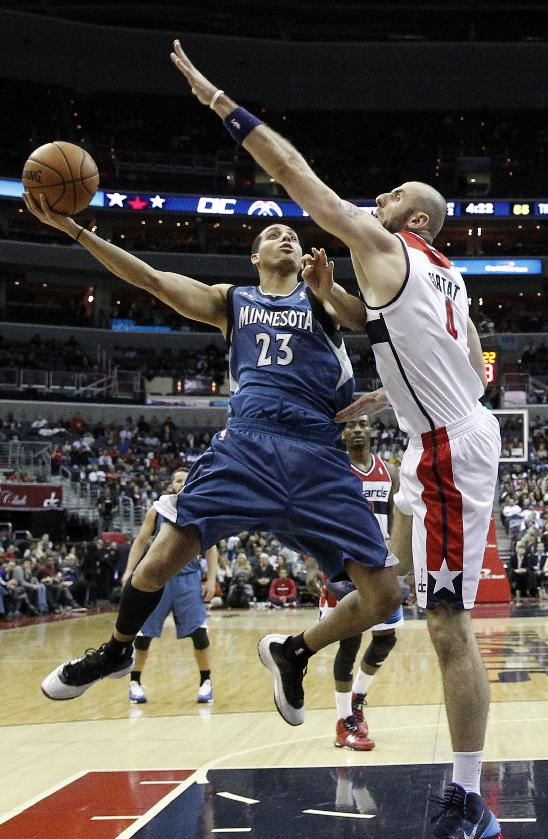 Minnesota Timberwolves guard Kevin Martin (23) shoots over Washington Wizards center Marcin Gortat (4), from Poland, in the first half of an NBA basketball game Tuesday, Nov. 19, 2013, in Washington. The Wizards won 104-100