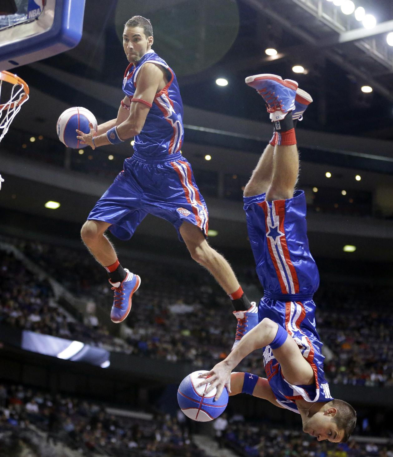 Members of the Detroit Pistons Flight Crew perform their dunks during a break in the second half of an NBA basketball game against the New York Knicks in Auburn Hills, Mich., Tuesday, Nov. 19, 2013