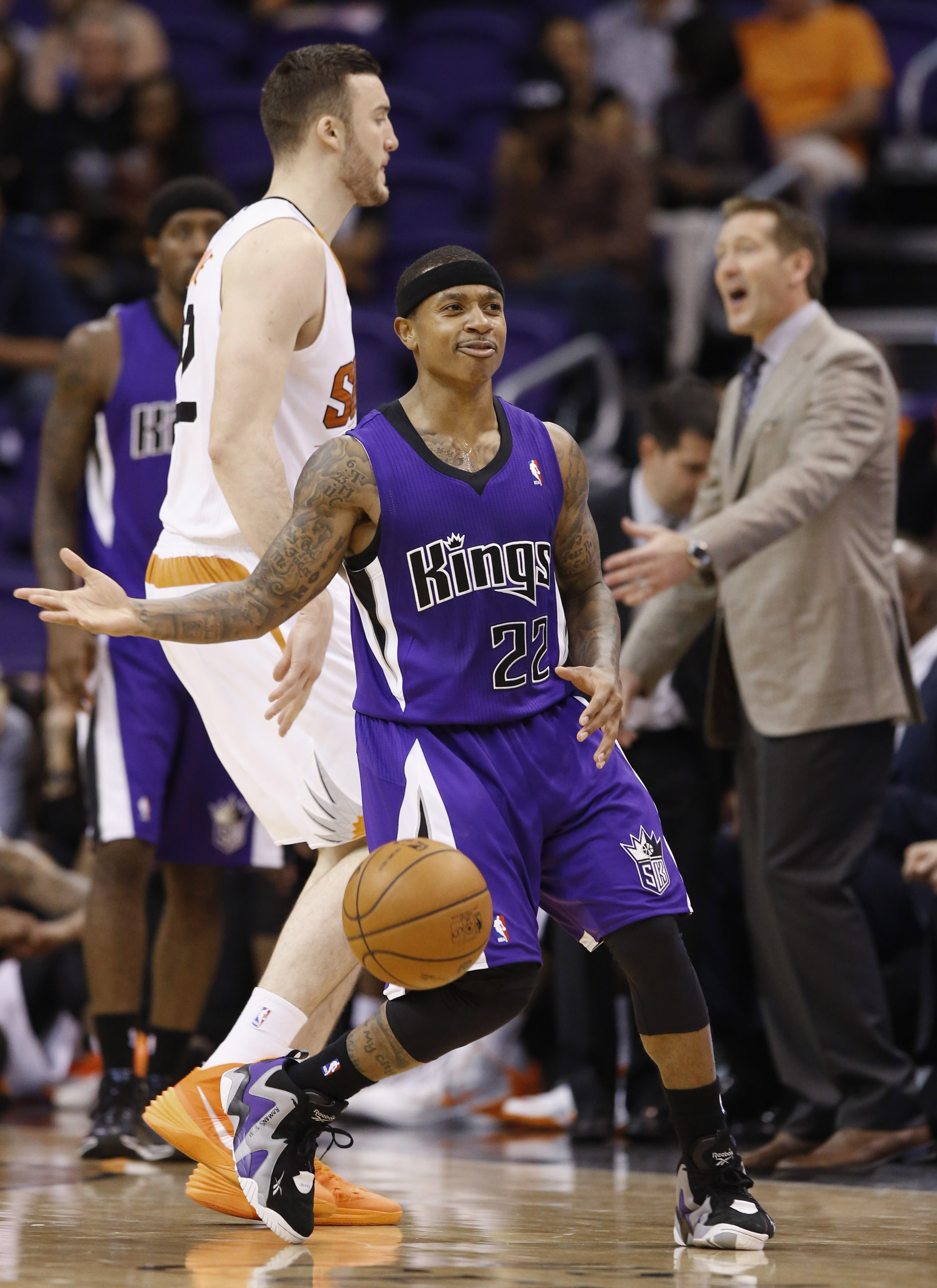 Sacramento Kings' Isaiah Thomas (22) gestures after being fouled by Phoenix Suns' Miles Plumlee, left, as Suns head coach Jeff Hornacek, right, shouts at his players during the second half of an NBA basketball game Wednesday, Nov. 20, 2013, in Phoenix.  The Kings defeated the Suns 113-106