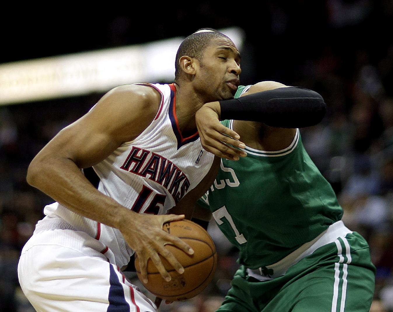Atlanta Hawks' Al Horford, left, collides with the arm of Boston Celtics' Jared Sullinger during the first quarter of an NBA basketball game, Saturday, Nov. 23, 2013, in Atlanta