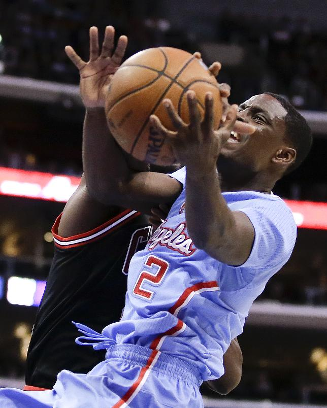 Los Angeles Clippers guard Darren Collison right, is fouled by Chicago Bulls center Nazr Mohammed during the first half of an NBA basketball game in Los Angeles, Sunday, Nov. 24, 2013