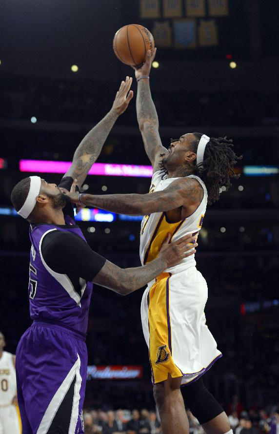Los Angeles Lakers center Jordan Hill, right, puts up a shot as Sacramento Kings center DeMarcus Cousins defends during the first half of an NBA basketball game Sunday, Nov. 24, 2013, in Los Angeles