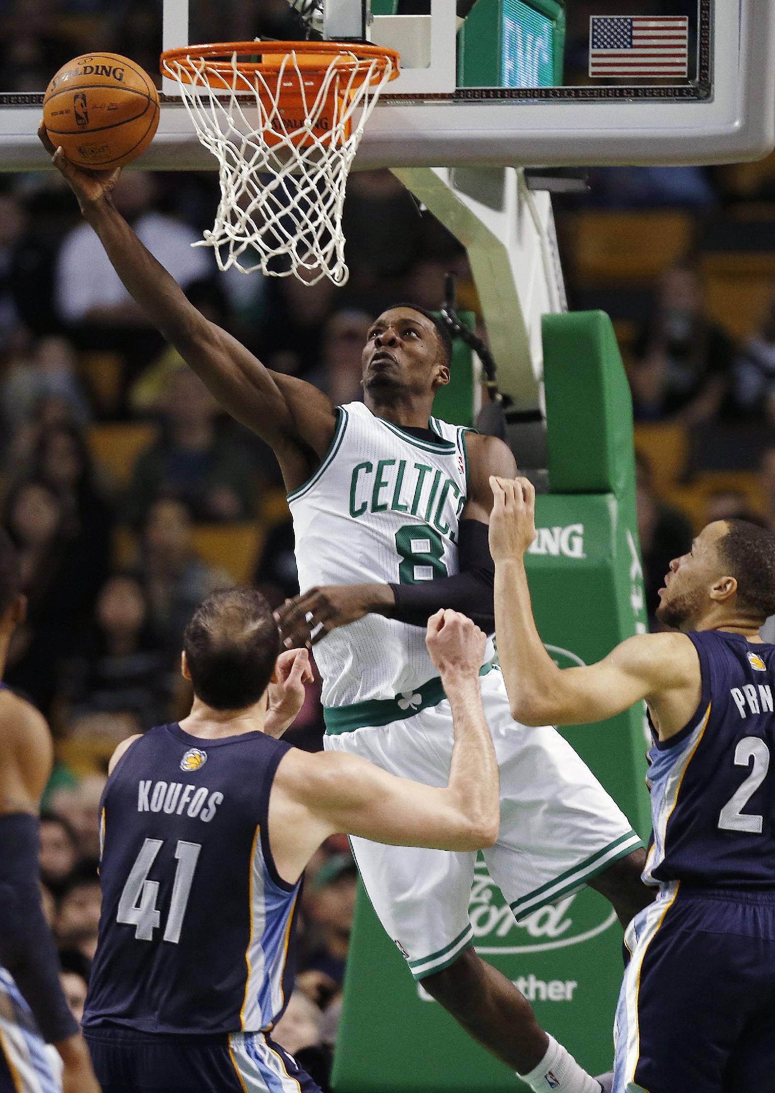 Boston Celtics' Jeff Green (8) shoots between Memphis Grizzlies' Kosta Koufos (41) and Tayshaun Prince (21) in the fourth quarter of an NBA basketball game in Boston, Wednesday, Nov. 27, 2013. The Grizzlies won 100-93