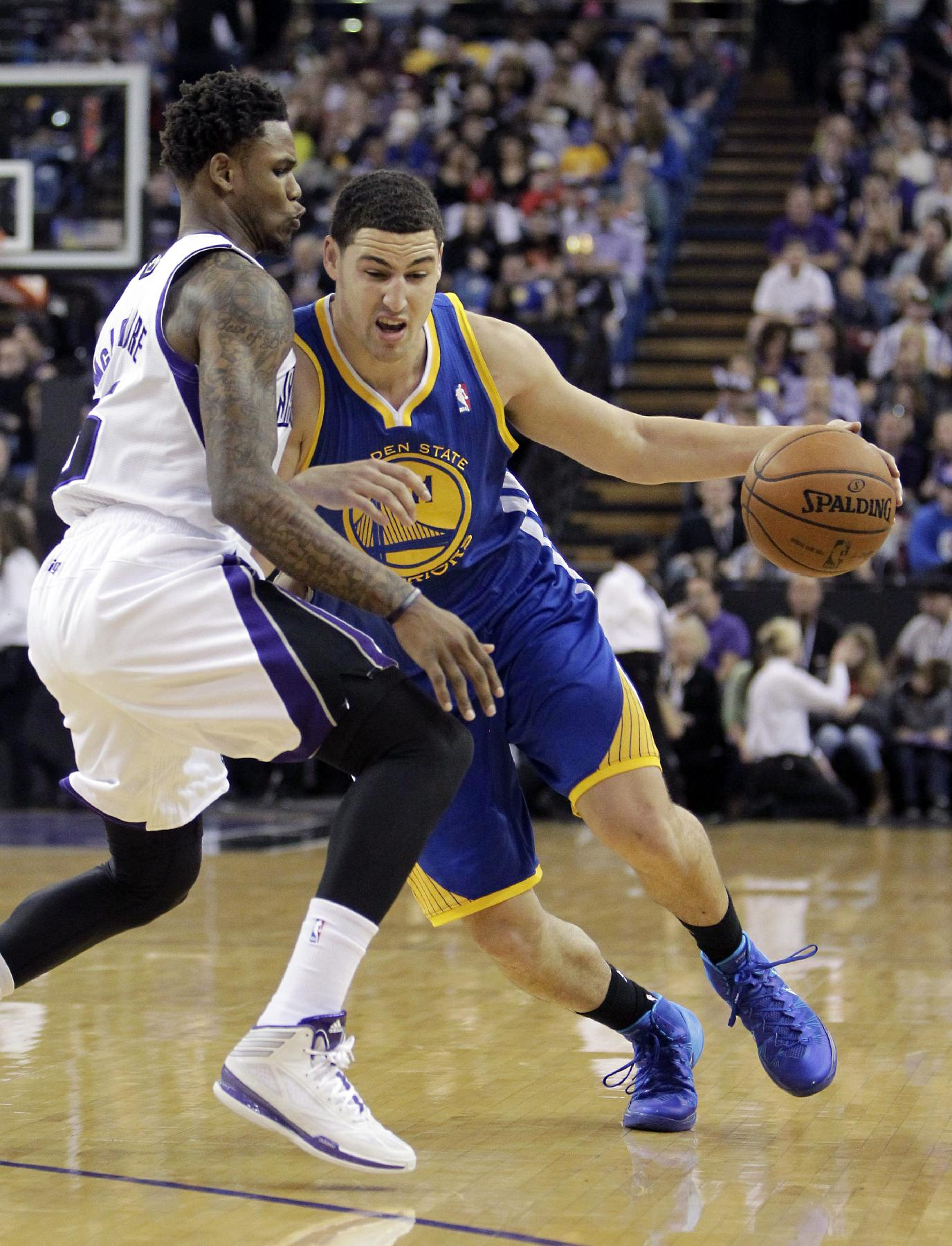 Golden State Warriors guard Klay Thompson, right, drives against Sacramento Kings guard Ben McLemore during the first quarter of an NBA basketball game in Sacramento, Calif., Sunday, Dec. 1, 2013