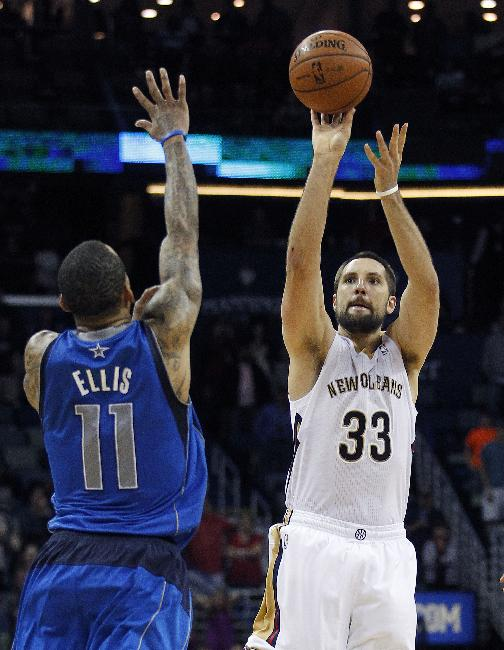 New Orleans Pelicans power forward Ryan Anderson (33) shoots and misses a desperation three-pointer at the end of regulation as Dallas Mavericks shooting guard Monta Ellis (11) covers during an NBA basketball game in New Orleans, Wednesday, Dec. 4, 2013. The Mavericks won 100-97
