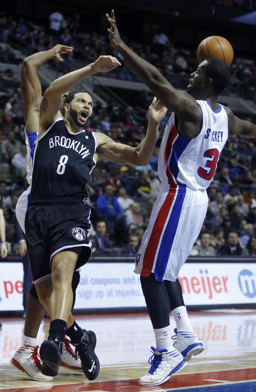 Brooklyn Nets guard Deron Williams (8) loses the ball against Detroit Pistons guard Rodney Stuckey (3) during the first half of an NBA basketball game on Friday, Dec. 13, 2013, in Auburn Hills, Mich