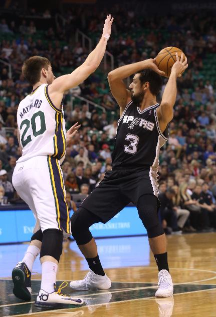 San Antonio Spurs' Marco Belinelli (3) looks to pass the ball as Utah Jazz's Gordon Hayward (20) defends in the first half of an NBA basketball game on Saturday, Dec. 14, 2013, in Salt Lake City