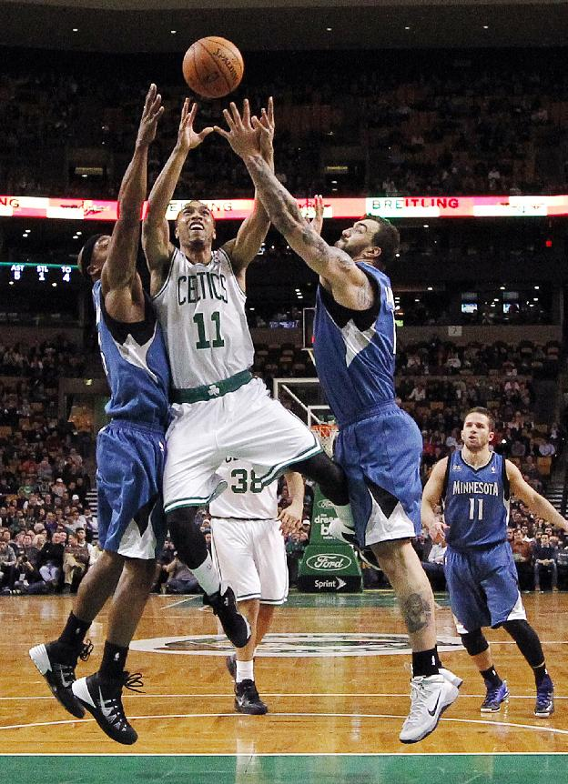 Boston Celtics' Courtney Lee (11) drives for the basket between Minnesota Timberwolves' Dante Cunningham, left, and Nikola Pekovic in the second quarter of an NBA basketball game in Boston, Monday, Dec. 16, 2013