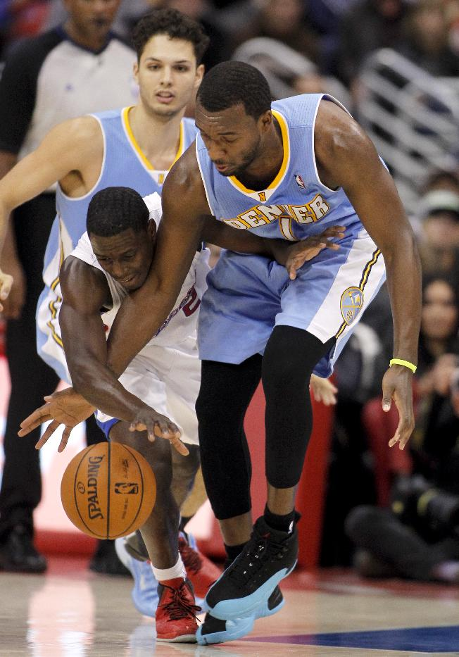 Denver Nuggets forward Jordan Hamilton, right, steals the ball away from Los Angeles Clippers guard Darren Collison, left, in the second half of an NBA basketball game in Los Angeles on Saturday, Dec. 21, 2013. Clippers won the game 112-91