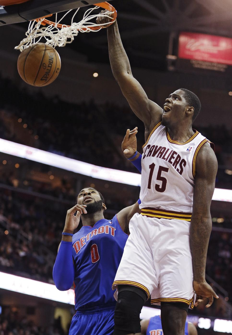 Cleveland Cavaliers' Anthony Bennett (15) dunks in front of Detroit Pistons' Andre Drummond (0) during the fourth quarter of an NBA basketball game Monday, Dec. 23, 2013, in Cleveland. The Pistons won 115-92