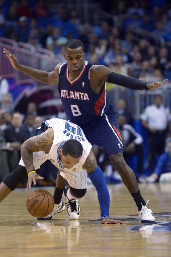 Orlando Magic guard Jameer Nelson (14) is fouled by Atlanta Hawks guard Shelvin Mack (8) during the second half of an NBA basketball game, Sunday, Dec. 29, 2013, in Orlando, Fla.. The Magic won 109-102
