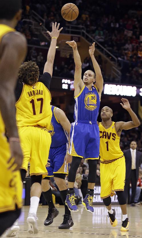 Golden State Warriors' Stephen Curry (30) shoots over Cleveland Cavaliers' Anderson Varejao (17), from Brazil, during the third quarter of an NBA basketball game, Sunday, Dec. 29, 2013, in Cleveland. Curry scored a team-high 29 points for the Warriors 108-104 win in overtime