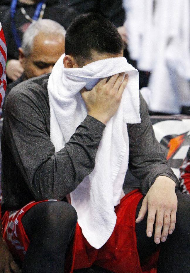 Houston Rockets guard Jeremy Lin puts his face in his towel after his team lost to Oklahoma City Thunder during an NBA basketball game, Sunday, Dec. 29, 2013, in Oklahoma City. Oklahoma City won 117-86