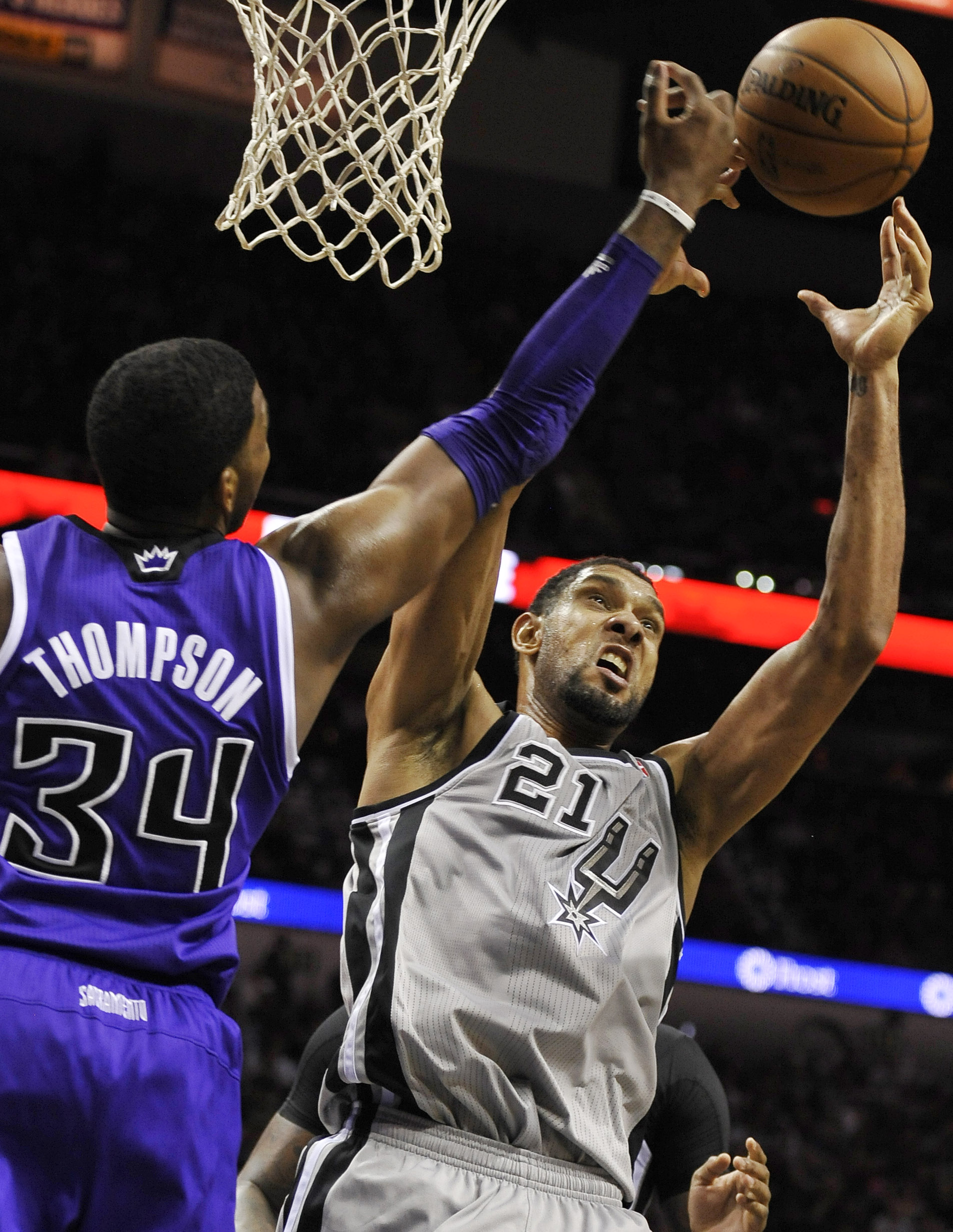 San Antonio Spurs forward Tim Duncan, right, chases a rebound against Sacramento Kings forward Jason Thompson during the second half of an NBA basketball game on Sunday, Dec. 29, 2013, in San Antonio. San Antonio won 112-104