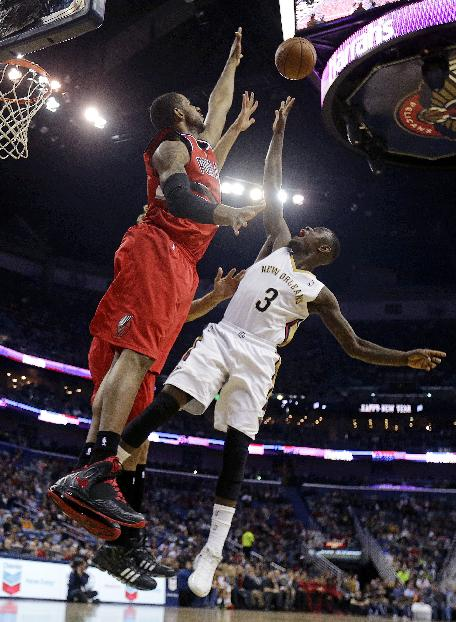 New Orleans Pelicans guard Anthony Morrow (3) goes to the basket against Portland Trail Blazers forward LaMarcus Aldridge and center Robin Lopez, behind, in the first half of an NBA basketball game in New Orleans, Monday, Dec. 30, 2013