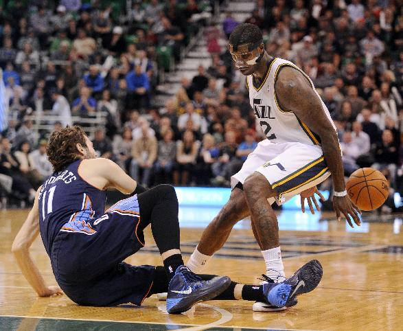 Charlotte Bobcats' Josh McRoberts (11) is called for a foul on Utah Jazz's Marvin Williams (2) in the second half of an NBA basketball game Monday, Dec. 30, 2013, in Salt Lake City. Jazz won 83-80
