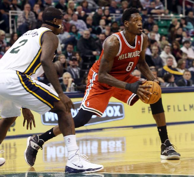 Milwaukee Bucks' Larry Sanders (8) looks to pass as Utah Jazz's Marvin Williams (2) defends during the second half of an NBA basketball game Thursday, Jan. 2, 2014, in Salt Lake City.  The Jazz won 96-87