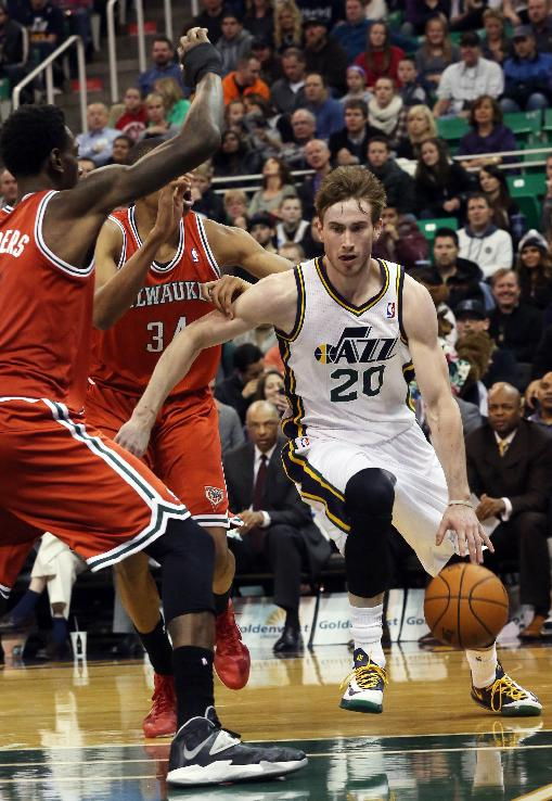 Utah Jazz's Gordon Hayward (20) dribbles past Milwaukee Bucks' Larry Sanders, left, and Milwaukee Bucks' Giannis Antetokounmpo, middle, in the second half of an NBA basketball game Thursday, Jan. 2, 2014, in Salt Lake City.  The Jazz won 96-87