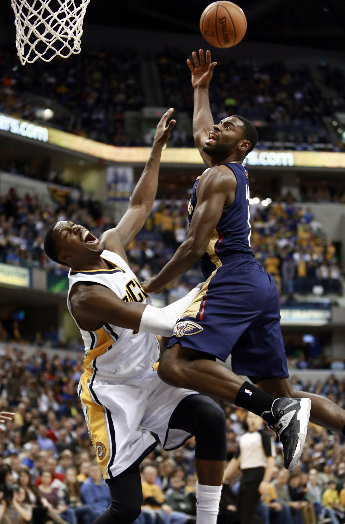 New Orleans Pelicans guard Tyreke Evans, right, puts up a shot as Indiana Pacers center Ian Mahinmi defends during the second half of an NBA basketball game in Indianapolis, Saturday, Jan. 4, 2014. The Pacers won 99-82