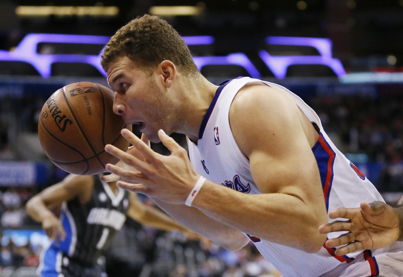Los Angeles Clippers' Blake Griffin eyes the ball before dunking against the Orlando Magic during the second half of an NBA basketball game in Los Angeles, Monday, Jan. 6, 2014. The Clippers won 101-81