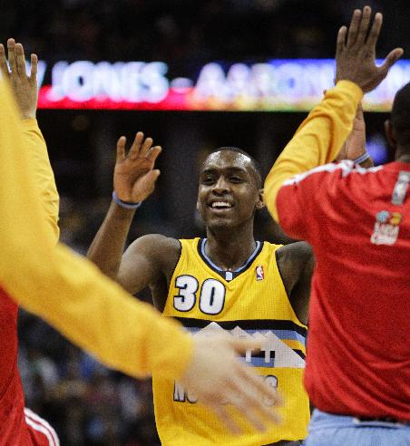 Denver Nuggets' Quincy Miller (30) reacts after making an uncontested slam dunk against the Oklahoma City Thunder during the third quarter of an NBA basketball game Thursday, Jan. 9, 2014, in Denver. Denver won 101-88