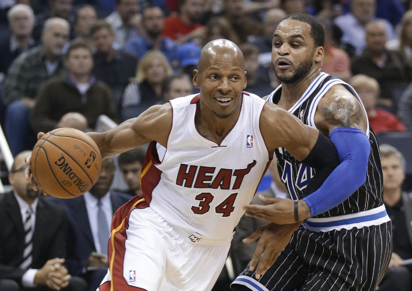 In this Jan. 4, 2014, file photo, Miami Heat's Ray Allen (34) drives around Orlando Magic's Jameer Nelson during an NBA basketball game in Orlando, Fla. Allen collaborated with the NBA to design a shooting shirt that teams will wear for certain games in February, part of what he hopes brings additional spotlight to Black History Month. The shirt features the likenesses of Frederick Douglass, Harriet Tubman, Bill Russell and Dr. Martin Luther King Jr., the civil rights activist whose life is celebrated on Monday