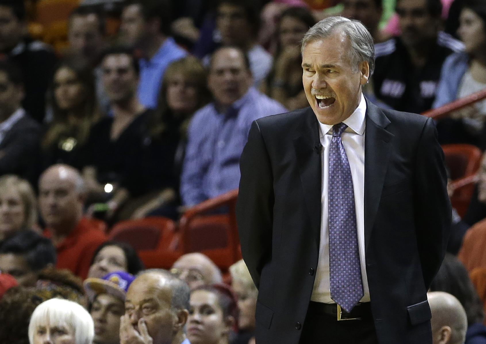 Los Angeles Lakers head coach Mike D'Antoni shouts instructions to players during the first quarter of an NBA basketball game against the Miami Heat in Miami, Thursday, Jan. 23, 2014