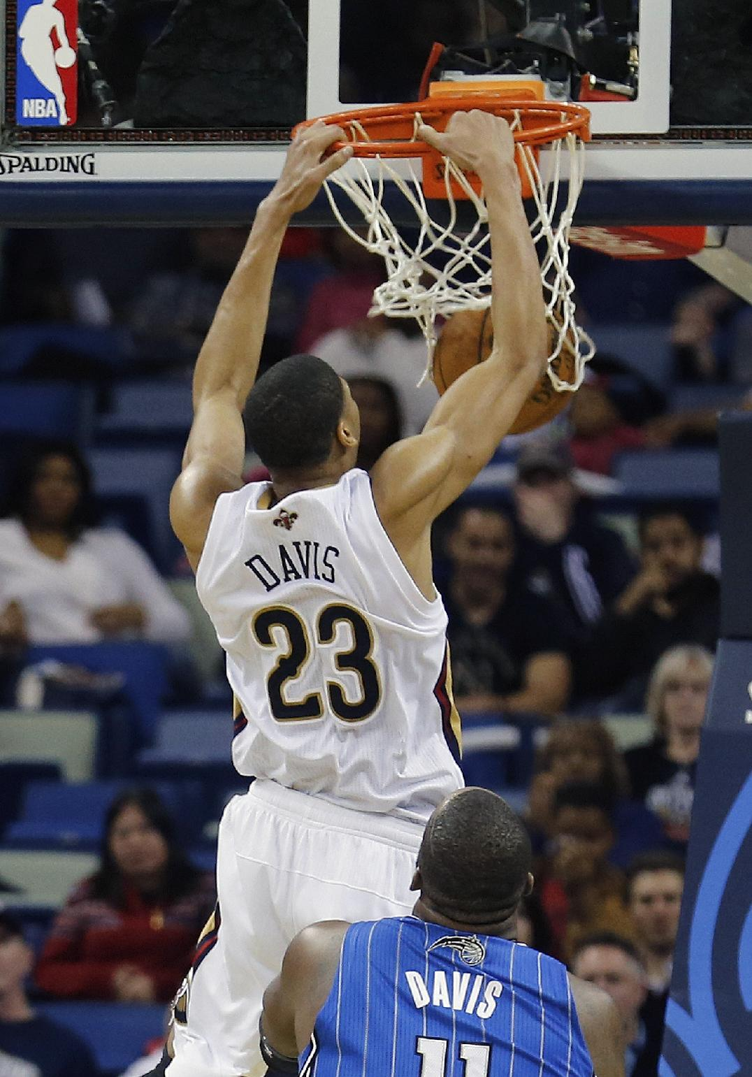 New Orleans Pelicans power forward Anthony Davis (23) scores in the second half of an NBA basketball game against the Orlando Magic in New Orleans, Sunday, Jan. 26, 2014. The Pelicans defeated the Magic 100-92. Davis scored 22 points and had a career-high 19 rebounds and seven blocked shots