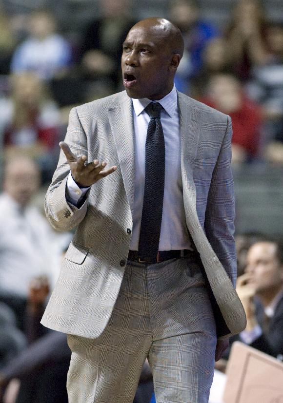 Orlando Magic coach Jacque Vaughn argues a foul call during the second half of an NBA basketball game against the Detroit Pistons on Tuesday, Jan. 28, 2014, in Auburn Hills, Mich