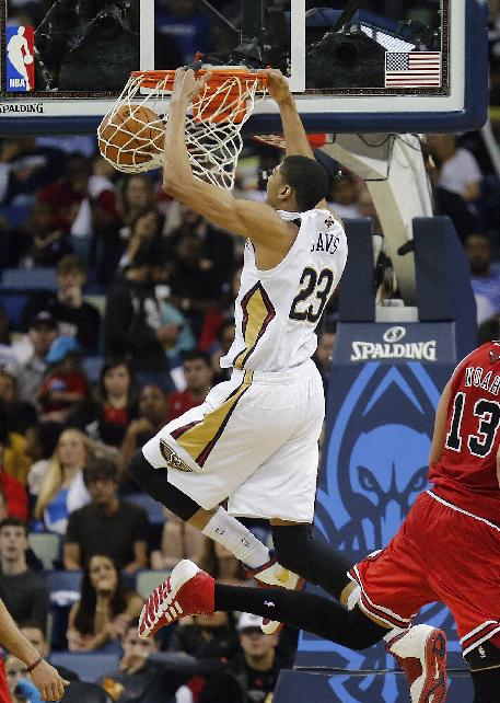 New Orleans Pelicans forward Anthony Davis (23) scores two of his 24 points against the Chicago Bulls, in the second half of an NBA basketball game in New Orleans, Saturday, Feb. 1, 2014. The Pelicans defeated the Bulls 88-79