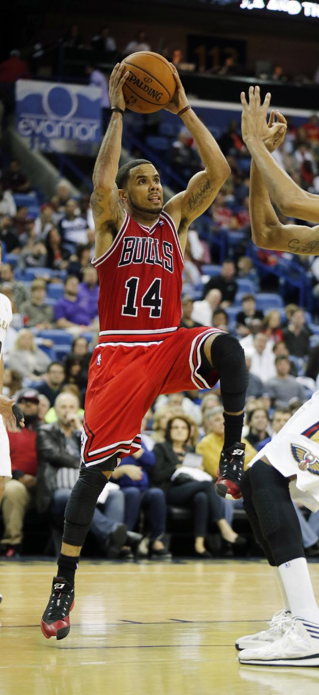 Chicago Bulls point guard D.J. Augustin (14) shoots during the second half of an NBA basketball game against the New Orleans Pelicans in New Orleans, Saturday, Feb. 1, 2014. The Pelicans defeated the Bulls 88-79