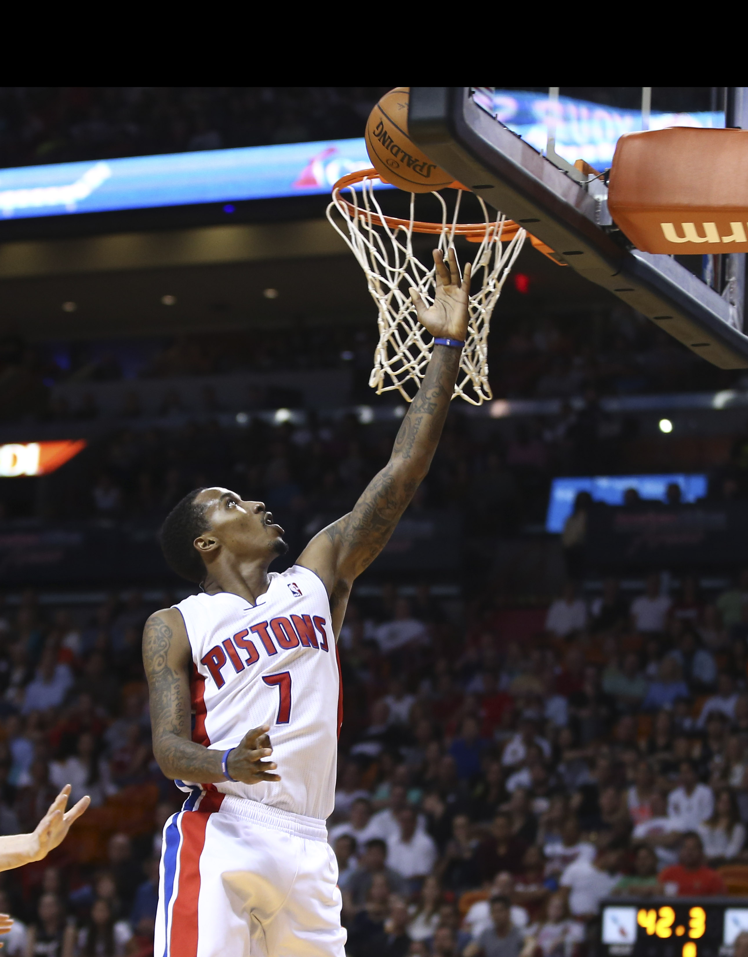 Detroit Pistons' Brandon Jennings scores two points against the Miami Heat during the second half of an NBA basketball game in Miami, Monday, Feb. 3, 2014. The Heat won 102-96