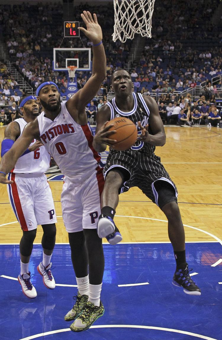 Orlando Magic's Victor Oladipo, right, gets in front of Detroit Pistons' Andre Drummond (0) for a shot during the first half of an NBA basketball game in Orlando, Fla., Wednesday, Feb. 5, 2014