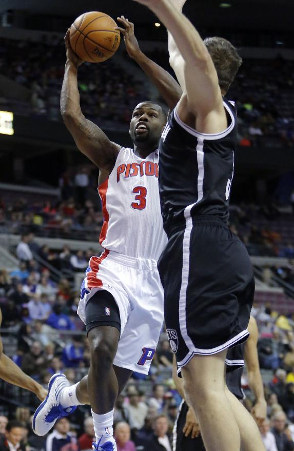 Detroit Pistons guard Rodney Stuckey (3) goes to the basket against Brooklyn Nets forward Mirza Teletovic (33) during the first half of an NBA basketball game Friday, Feb. 7, 2014, in Auburn Hills, Mich