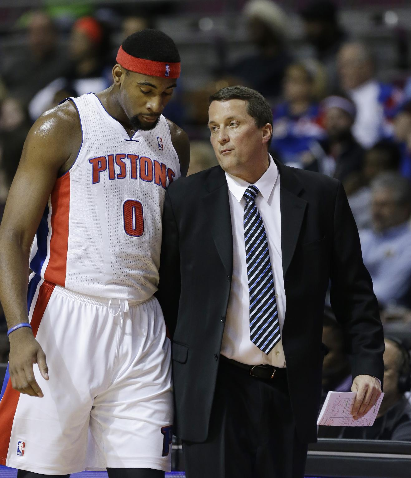 Detroit Pistons center Andre Drummond (0) talks with interim head coach John Loyer during the first half of an NBA basketball game against the San Antonio Spurs in Auburn Hills, Mich., Monday, Feb. 10, 2014