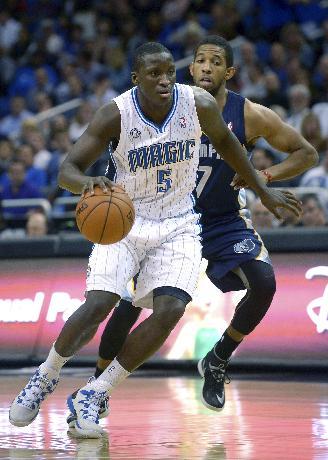 Orlando Magic shooting guard Victor Oladipo (5) drives past Memphis Grizzlies point guard Darius Morris during the first half of an NBA basketball game in Orlando, Fla., Wednesday, Feb. 12, 2014