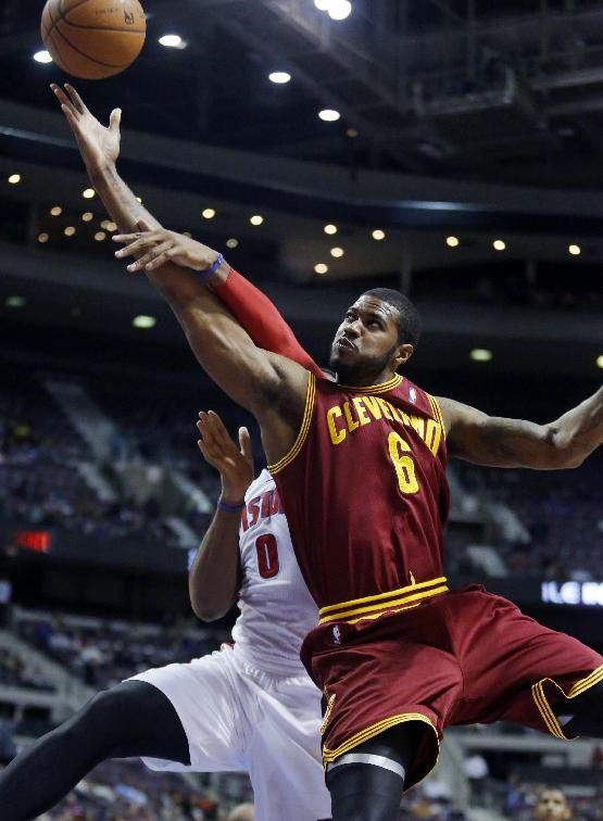 Cleveland Cavaliers forward Earl Clark (6) is fouled by Detroit Pistons center Andre Drummond (0) while laying up the ball during the first half of an NBA basketball game Wednesday, Feb. 12, 2014, in Auburn Hills, Mich
