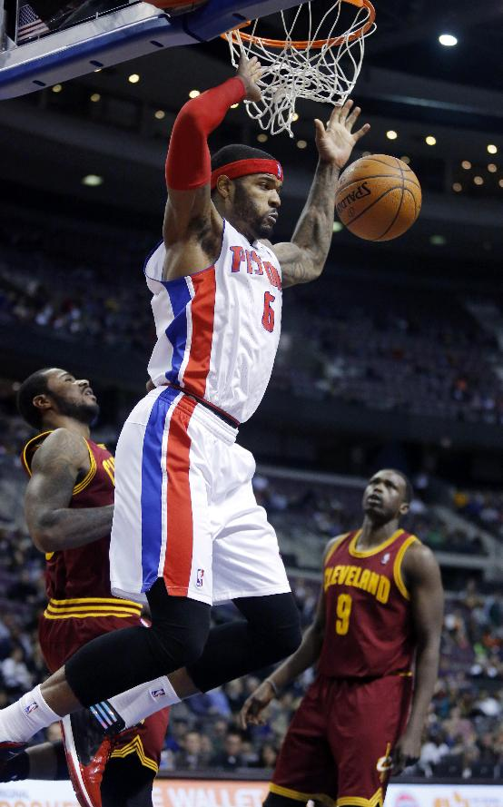 Detroit Pistons forward Josh Smith (6) dunks the ball in front of Cleveland Cavaliers forwards Earl Clark and Luol Deng (9) during the second half of an NBA basketball game Wednesday, Feb. 12, 2014, in Auburn Hills, Mich