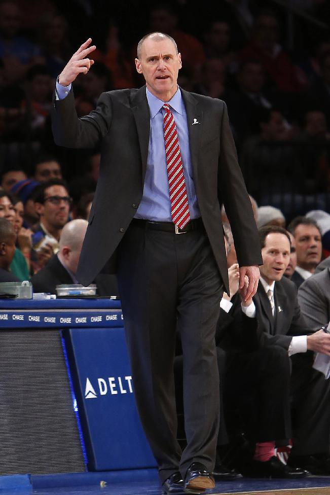 Dallas Mavericks coach Rick Carlisle signals to his team during the second half of an NBA basketball game against the New York Knicks, Monday, Feb. 24, 2014, in New York. Dallas won 110-108