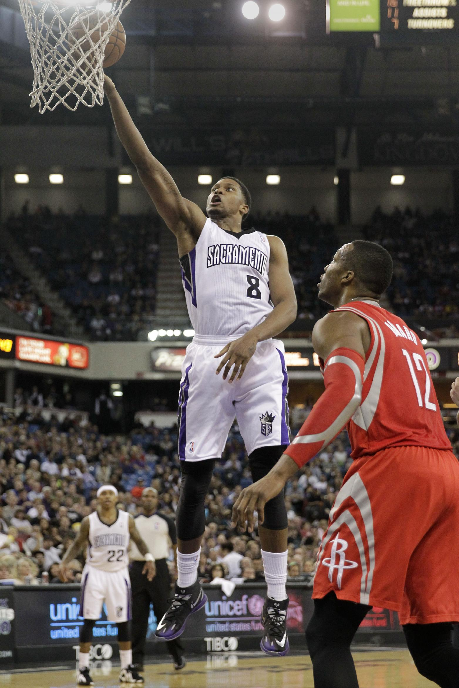 Sacramento Kings forward Rudy Gay, left, drives to the basket against Houston Rockets center Dwight Howard during the third quarter of an NBA basketball game in Sacramento, Calif., Tuesday Feb. 25, 2014.  The Rockets won 129-103