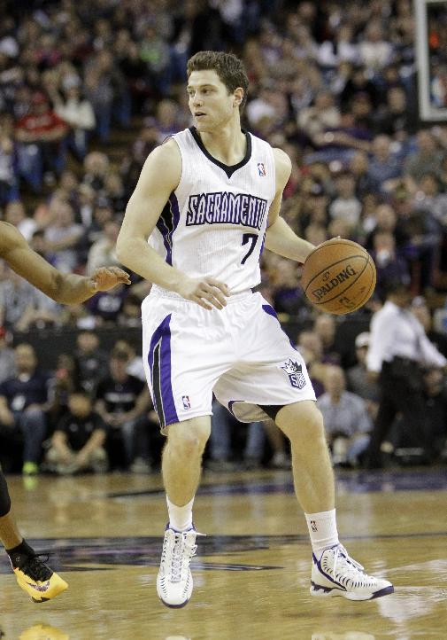 FILE -- In this Jan. 12, 2014, file photo, Sacramento Kings guard Jimmer Fredette looks to pass during an NBA basketball game against the Cleveland Cavaliers in Sacramento, Calif. The Kings announced they have completed a buyout of Fredette's contract, the team said Thursday, Feb. 27, 2014, clearing the way for the former BYU sensation to become a free agent
